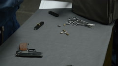 Pistol and bullets on the table Stock Footage