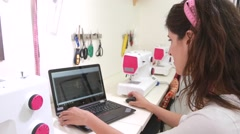 Seamstress with laptop in sawing studio Stock Footage