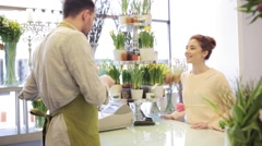 Florist showing flowers to woman at flower shop Stock Footage