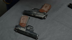 Pistol and bullets on the table - stock footage