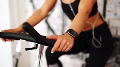 Smart watch showing a heart rate of exercising woman in gym - stock footage