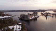 Aerial shot of a medieval castle in the middle of a lake landscape Stock Footage