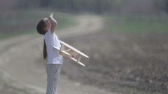 Boy in nature plays with the layout of the aircraft. Stock Footage