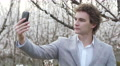 Young pretty man taking shooting selfie photo via smart phone for instagram Footage