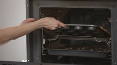Baking cupcake in the oven - stock footage