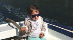 Little girl sailing with wooden boat Stock Footage