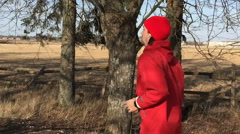 Athlete in red clothes runs on the park alley the camera follows him - stock footage