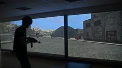 Man shooting in laser shooting range Stock Footage