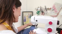 Seamstress working at sewing machine  Stock Footage