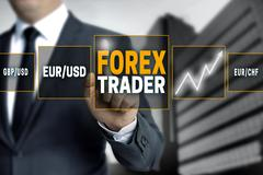 Forex trader touchscreen is operated by businessman Stock Photos