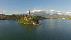 Camera flying over lake in Bled Stock Footage