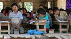 Burmese girls and boys in a local school during the lesson. Mrauk U, Myanmar Stock Footage