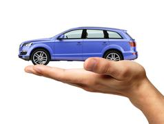Human hand with a car on the palm. Stock Illustration