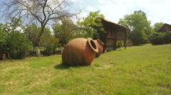 Kvevri clay to grass Stock Footage