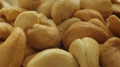 Cashew nuts background close-up slow panorama. Macro. Dolly shot. Stock Footage