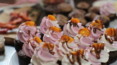 Decorating cupcakes Stock Footage