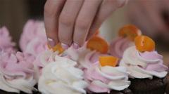 Decorating cupcakes Stock Footage