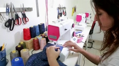Seamstress works with sewing machine Stock Footage