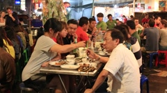 People eating street food in Chinatown.  China Town, Thailand Stock Footage