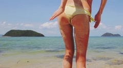 Sandy ass on the tropical ocean shore. slow motion - stock footage