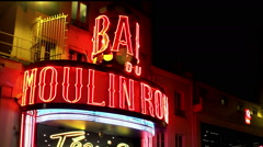 The Moulin Rouge cabaret at night. Paris. France. Arkistovideo