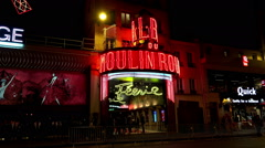 The Moulin Rouge cabaret at night. Paris. France. Stock Footage
