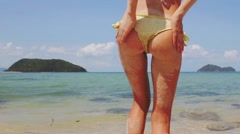 Sandy ass of a young beautiful woman on the beach - stock footage