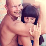 Athletic beauty man and sexy girl kissing hand - stock photo