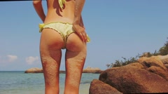 Sandy ass on the beach. slow motion - stock footage