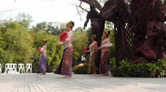 Women in Thai national clothes dancing on stage dolly shot Stock Footage