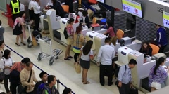 Passenger arrive at check-in counters at airport in Bangkok, Thailand Stock Footage