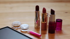Make-up  colorful cosmetic palette, lipstick, brushes and nail laquer bottles Stock Footage