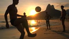 Locals Playing Ball at Sunset in Ipanema Beach, Rio de Janeiro, Brazil Stock Footage