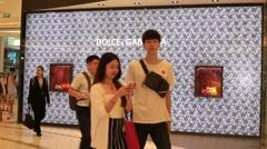 People walking near the Dolce & Gabbana store in Bangkok, Thailand - stock footage