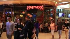 People walking near Swensen's restaurant in Bangkok , Thailand Stock Footage