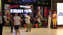 People walking near McDonald's restaurant . Bangkok , Thailand Stock Footage