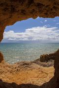 ocean cave at the coast of algarve, Portugal - stock photo