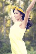 Beautiful brunette woman fashion style outdoors in yellow dress concept idea Stock Photos