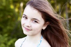 Beautiful natural beauty  little girl schoolgirl student in  dress, a summer Stock Photos