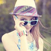 Beautiful natural beauty  little girl schoolgirl student wears glasses  dress - stock photo