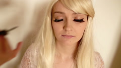 Makeup, applying eyeliner Stock Footage