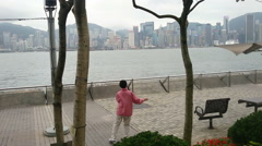 Woman is engaged wushu against the background of Hong Kong Stock Footage