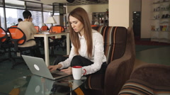 Shop Online. Red-haired Female Purchases By Debit Card With Laptop Stock Footage