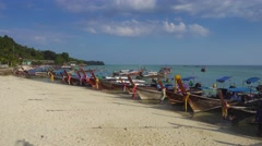 Long tail boats on beach of Phi Phi Don island Stock Footage