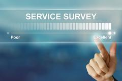 business hand clicking excellent service survey on virtual screen - stock photo