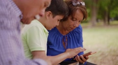 14-Child Helping Grandma Text Messaging On Mobile Phone - stock footage