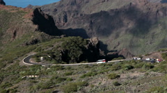 Touristic bus and cars drive narrow road TF-436. Masca, Tenerife Stock Footage