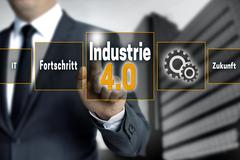 Industrie 4.0 in german industry touchscreen is operated by businessman backg Stock Photos