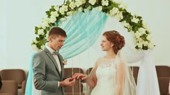 The groom wears a wedding ring to the bride Stock Footage