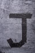 Black grunge alphabet. Letter J - stock photo